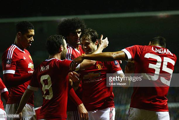 Daley Blind of Manchester United celebrates with Juan Mata and team mates as he scores their second goal during the Emirates FA Cup fourth round...