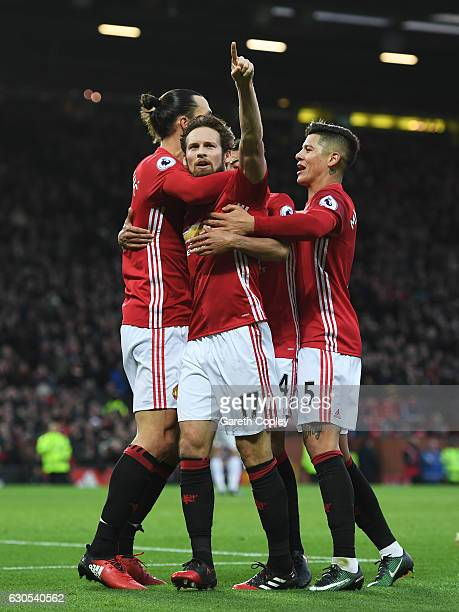 Daley Blind of Manchester United celebrates with teammates after scoring the opening goal during the Premier League match between Manchester United...