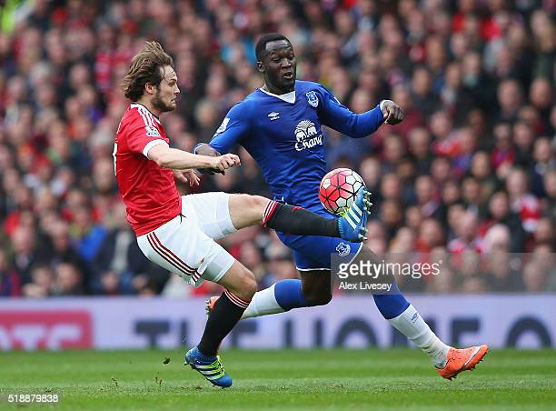 Daley Blind of Manchester United challenges Romelu Lukaku of Everton during the Barclays Premier League match between Manchester United and Everton...