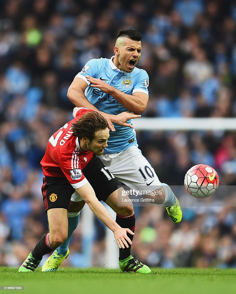Daley Blind of Manchester United clashes with Sergio Aguero of Manchester City during the Barclays Premier League match between Manchester City and Manchester United at Etihad Stadium on March 20, 2016 in Manchester, United Kingdom.