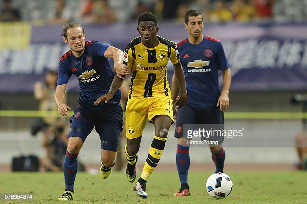 Daley Blind of Manchester United competes for the ball with Ousmane Dembele of Borussia Dortmund during the International Champions Cup match between...