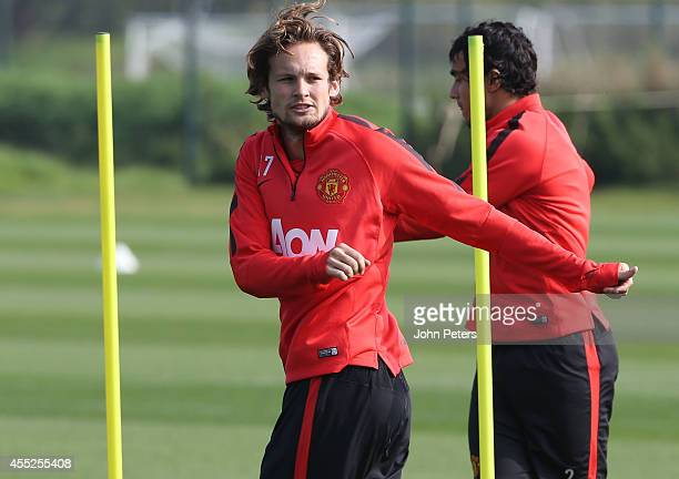 Daley Blind of Manchester United in action during a first team training session at Aon Training Complex on September 11 2014 in Manchester England