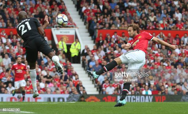 Daley Blind of Manchester United in action with Angelo Ogbonna of West ham United during the Premier League match between Manchester United and West...