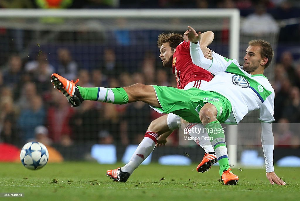 Daley Blind of Manchester United in action with Bas Dost of VfL Wolfsburg during the UEFA Champions League Group C match between Manchester United and VfL Wolfsburg at Old Trafford on September 30, 2015 in Manchester, United Kingdom.