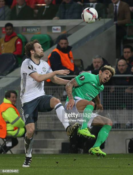 Daley Blind of Manchester United in action with Kevin Malcuit of AS SaintEtienne during the UEFA Europa League Round of 32 second leg match between...
