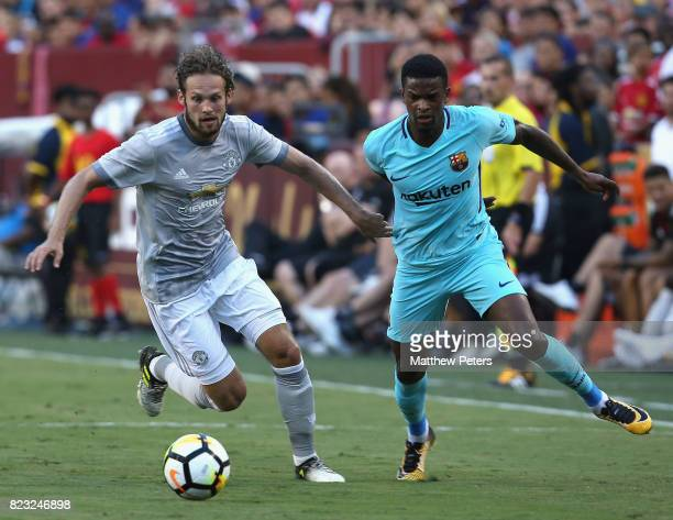 Daley Blind of Manchester United in action with Nelson Semedo of Barcelona during the International Champions Cup 2017 preseason friendly match...