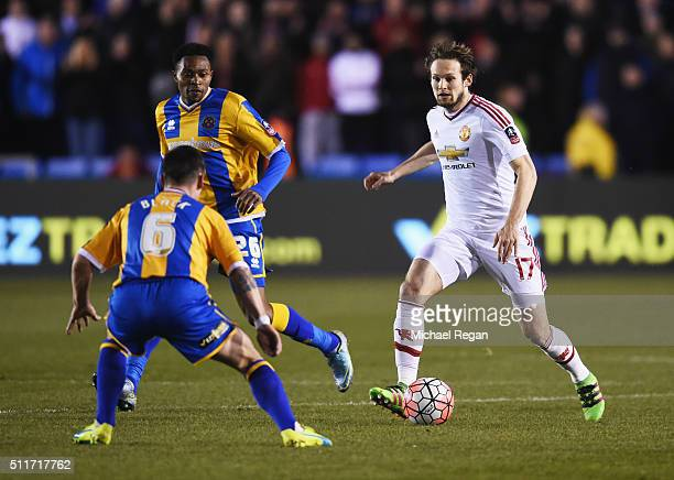 Daley Blind of Manchester United is faced by Ian Black of Shrewsbury Town during the Emirates FA Cup fifth round match between Shrewsbury Town and...
