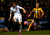 Daley Blind of Manchester United passes the ball under pressure from Richard Tait of Cambridge United during the FA Cup Fourth Round match between...