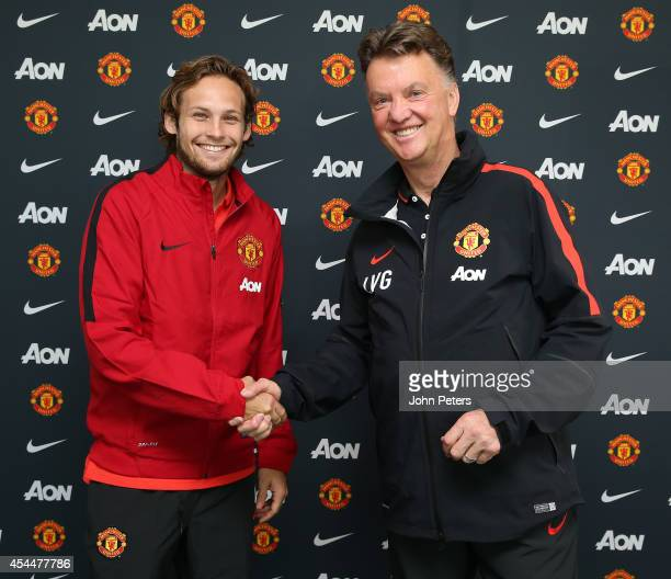 Daley Blind of Manchester United poses with manager Louis van Gaal after signing for the club at Aon Training Complex on August 31 2014 in Manchester...
