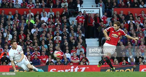 Daley Blind of Manchester United scores their first goal during the Barclays Premier League match between Manchester United and Liverpool on...
