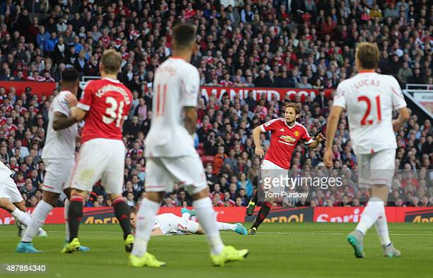 Daley Blind of Manchester United scores their first goal during the Barclays Premier League match between Manchester United and Liverpool at Old...