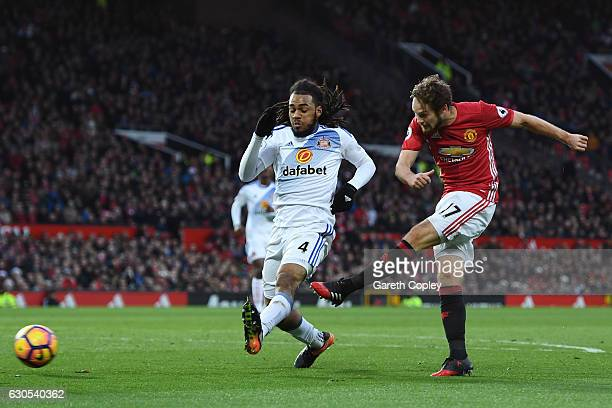Daley Blind of Manchester United shoots past Jason Denayer of Sunderland to score the opening goal during the Premier League match between Manchester...