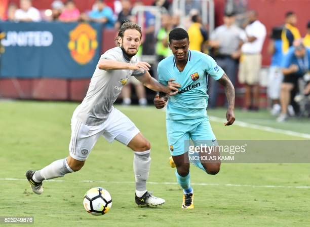 Daley Blind of Manchester United vies for the ball with Nelson Semedo of Barcelona during their International Champions Cup football match on July 26...