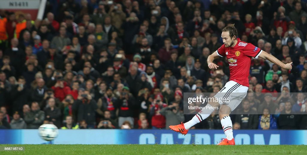 Daley Blind of Manchester Unitedscores their second goal during the UEFA Champions League group A match between Manchester United and SL Benfica at Old Trafford on October 31, 2017 in Manchester, United Kingdom.