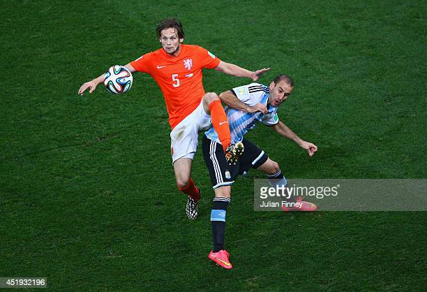 Daley Blind of the Netherlands and Rodrigo Palacio of Argentina compete for the ball during the 2014 FIFA World Cup Brazil Semi Final match between...