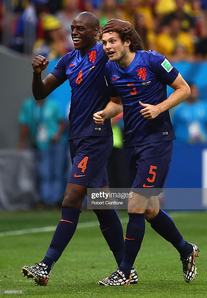 <a gi-track='captionPersonalityLinkClicked' href=/galleries/search?phrase=Daley+Blind&family=editorial&specificpeople=5566498 ng-click='$event.stopPropagation()'>Daley Blind</a> of the Netherlands (R) celebrates scoring his team's second goal with teammate <a gi-track='captionPersonalityLinkClicked' href=/galleries/search?phrase=Bruno+Martins+Indi&family=editorial&specificpeople=7155940 ng-click='$event.stopPropagation()'>Bruno Martins Indi</a> during the 2014 FIFA World Cup Brazil Third Place Playoff match between Brazil and the Netherlands at Estadio Nacional on July 12, 2014 in Brasilia, Brazil.