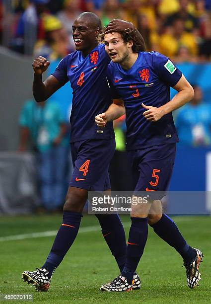 Daley Blind of the Netherlands celebrates scoring his team's second goal with teammate Bruno Martins Indi during the 2014 FIFA World Cup Brazil Third...