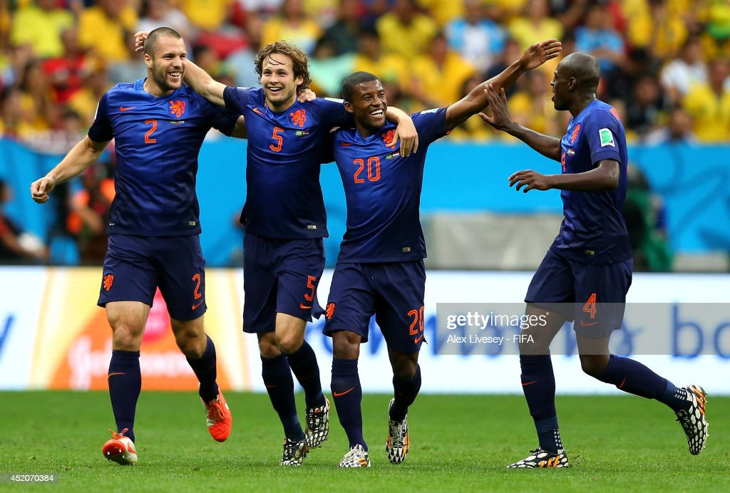<a gi-track='captionPersonalityLinkClicked' href=/galleries/search?phrase=Daley+Blind&family=editorial&specificpeople=5566498 ng-click='$event.stopPropagation()'>Daley Blind</a> (2nd L) of the Netherlands celebrates scoring his team's second goal with his teammtes <a gi-track='captionPersonalityLinkClicked' href=/galleries/search?phrase=Ron+Vlaar&family=editorial&specificpeople=605352 ng-click='$event.stopPropagation()'>Ron Vlaar</a> (1st L), <a gi-track='captionPersonalityLinkClicked' href=/galleries/search?phrase=Georginio+Wijnaldum&family=editorial&specificpeople=2146603 ng-click='$event.stopPropagation()'>Georginio Wijnaldum</a> (2nd R) and <a gi-track='captionPersonalityLinkClicked' href=/galleries/search?phrase=Bruno+Martins+Indi&family=editorial&specificpeople=7155940 ng-click='$event.stopPropagation()'>Bruno Martins Indi</a> (1st R) during the 2014 FIFA World Cup Brazil 3rd Place Playoff match between Brazil and Netherlands at Estadio Nacional on July 12, 2014 in Brasilia, Brazil.
