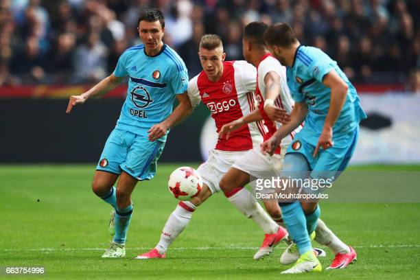 Daley Sinkgraven of Ajax battles for the ball with Steven Berghuis of Feyenoord Rotterdam during the Dutch Eredivisie match between Ajax Amsterdam...