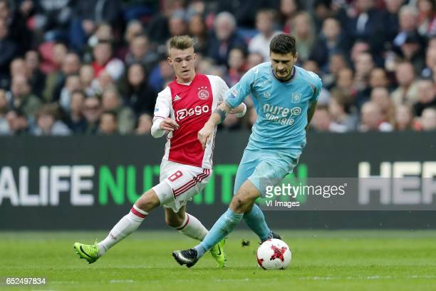 Daley Sinkgraven of Ajax Mateusz Klich of FC Twenteduring the Dutch Eredivisie match between Ajax Amsterdam and FC Twente Enschede at the Amsterdam...