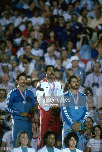 Jurgen Hingsen of West Germany Daley Thompson of Great Britain and Siegfried Wentz of West Germany stand on the podium during the medal ceremony at...
