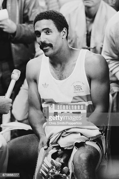 Daley Thompson of Great Britain is interviewed during a break in the men's decathlon competition inside the Olympic Stadium at the 1988 Summer...
