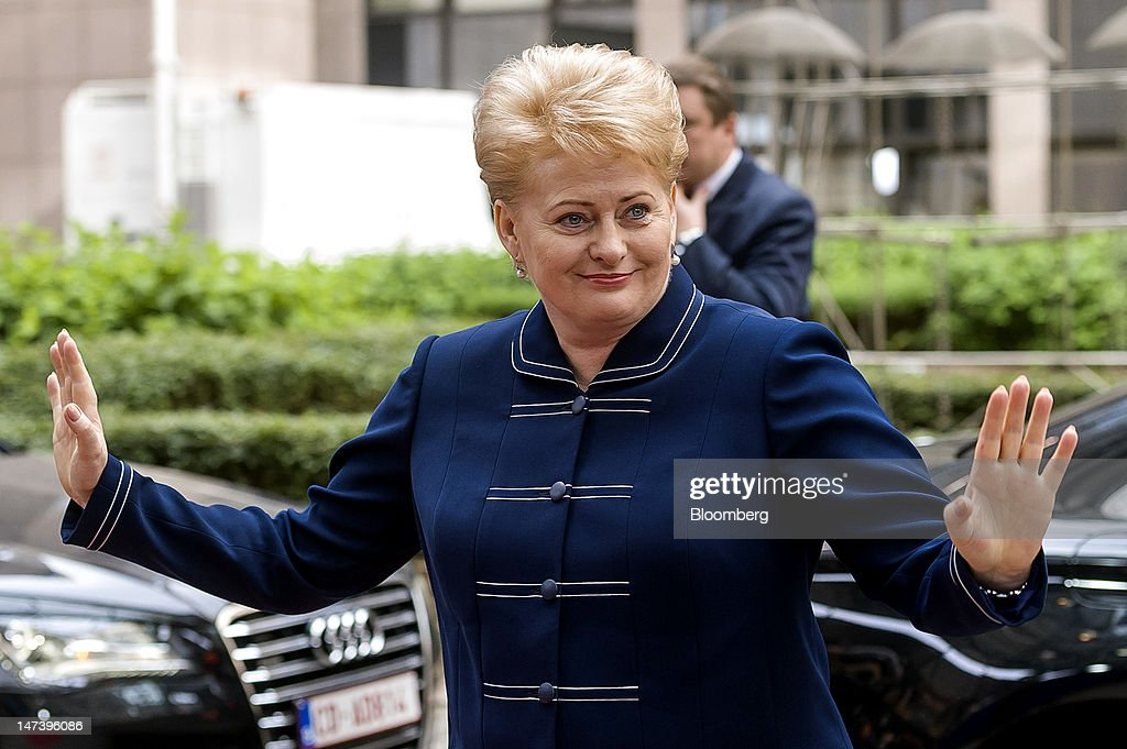 <a gi-track='captionPersonalityLinkClicked' href=/galleries/search?phrase=Dalia+Grybauskaite&family=editorial&specificpeople=654850 ng-click='$event.stopPropagation()'>Dalia Grybauskaite</a>, Lithuania's president, smiles and gestures as she arrives for the second day of the European Leaders (EU) summit at the European Council headquarters in Brussels, Belgium, on Friday, June 29, 2012. Euro-area leaders agreed to relax conditions on emergency loans for Spanish banks and possible help for Italy as an outflanked German Chancellor Angela Merkel gave in on expanded steps to stem the debt crisis. Photographer: Jock Fistick/Bloomberg via Getty Images