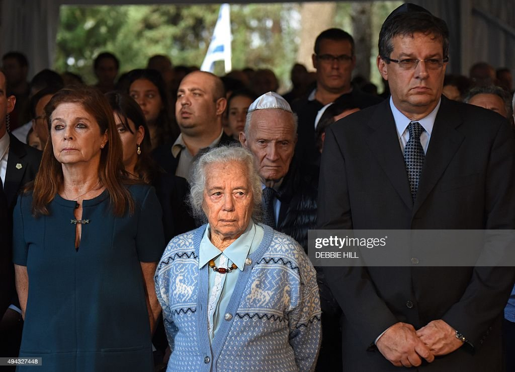 Dalia Rabin (L) stands next to her aunt Rachel and her brother Yuval Rabin during the official memorial ceremony marking the 20th anniversary of the assassination of her late father Israeli prime minister Yitzhak Rabin in the Mt. Herzl Cemetery in Jerusalem, on October 26, 2015. Rabin was assassinated by an Israeli right-wing extremist who opposed his concessions for peace with the Palestinians. AFP PHOTO / POOL / DEBBIE HILL