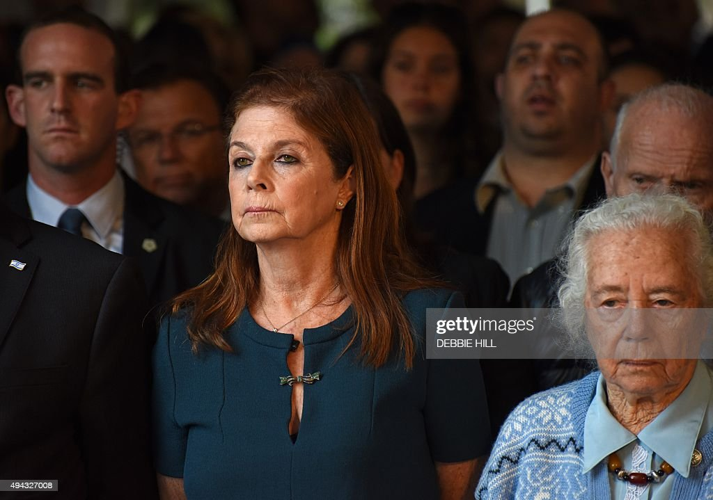 Dalia Rabin (L) stands next to her aunt Rachel as they attend the official memorial ceremony marking the 20th anniversary of the assassination of her father, late Israeli prime minister Yitzhak Rabin in the Mt. Herzl Cemetery in Jerusalem, on October 26, 2015. Rabin was assassinated by an Israeli right-wing extremist who opposed his concessions for peace with the Palestinians. AFP PHOTO / POOL / DEBBIE HILL