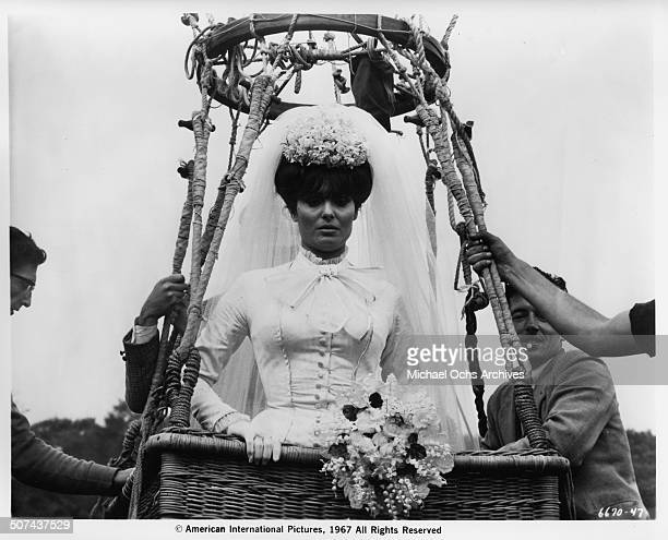 Daliah Lavi as Madelaine in a wedding dress as she takes off in a hot air balloon basket in a scene from the movie 'Those Fantastic Flying Fools'...