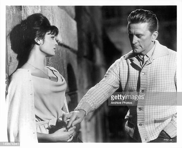 Daliah Lavi watches as Kirk Douglas touches her hand in a scene from the film 'Two Weeks In Another Town' 1962