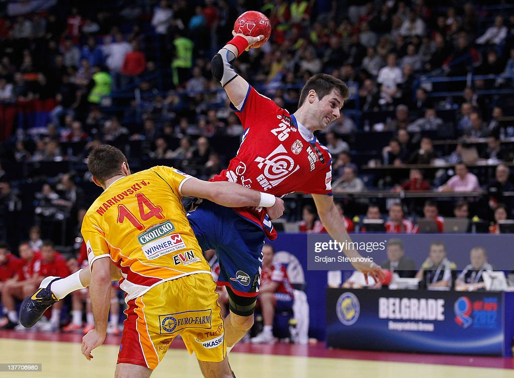 Dalibor Cutura (R) of Serbia battles with Velko Markoski (L) of Macedonia during the Men's European Handball Championship 2012 second round group one match between Serbia and Macedonia at Arena Hall on January 25, 2012 in Belgrade, Serbia.