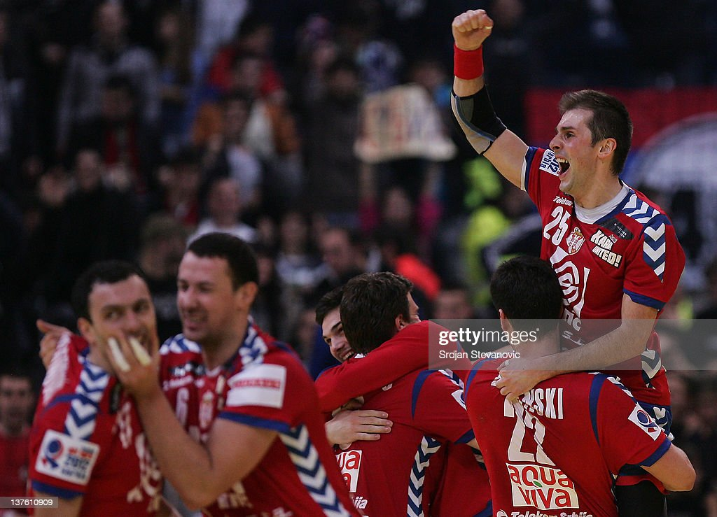 Dalibor Cutura (R) of Serbia celebrates victory against Sweden during the Men's European Handball Championship 2012 second round group one match between Serbia and Sweden at Arena Hall on January 23, 2012 in Belgrade, Serbia.