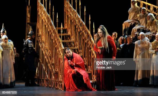 Dalibor Jenis as Macbeth and Anna Pirozzi as Lady Macbeth with artists of the company in Teatro Regio Torino's production of Giuseppe Verdi's Macbeth...