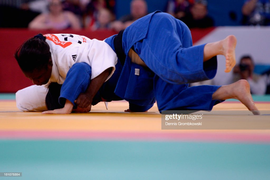 Dalidaivis Rodriguez Clark of Cuba and Tong Zhou of China compete in the Women's 63kg Judo Gold Medal Contest on day 2 of the London 2012 Paralympic...