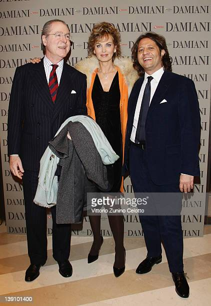 Dalila Di Lazzaro with her husband and Guido Damiani attend a cocktail party held at Damiani Flagship store on February 16 2012 in Milan Italy