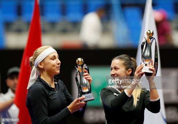 Dalila Jakupovic and Nadiia Kichenok pose with their trophies after they became women's double tennis champions during the TEB BNP Paribas Istanbul...