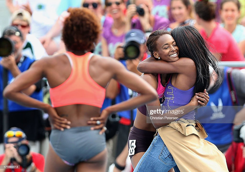Dalilah Muhammad is congratulated by Lashinda Demus after winning the 400 Meter Hurdles on day four of the 2013 USA Outdoor Track & Field Championships at Drake Stadium on June 23, 2013 in Des Moines, Iowa.