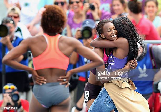 Dalilah Muhammad is congratulated by Lashinda Demus after winning the 400 Meter Hurdles on day four of the 2013 USA Outdoor Track Field Championships...