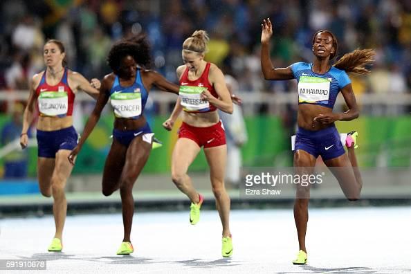 Dalilah Muhammad of the United States gold Sara Slott Petersen of Denmark silver and Ashley Spencer of the United States bronze cross the finishline...