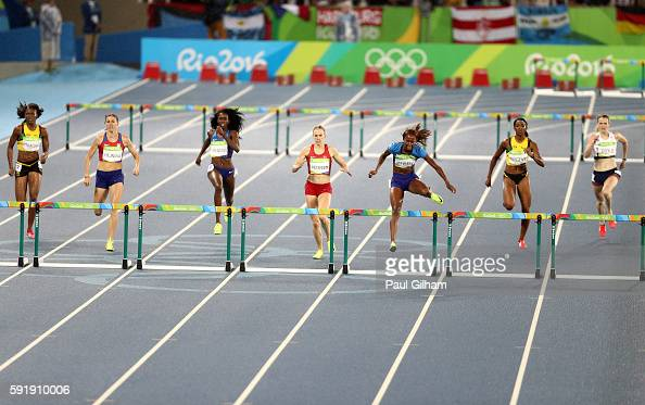 Dalilah Muhammad of the United States Sara Slott Petersen of Denmark and Ashley Spencer of the United States compete in the Women's 400m Hurdles...