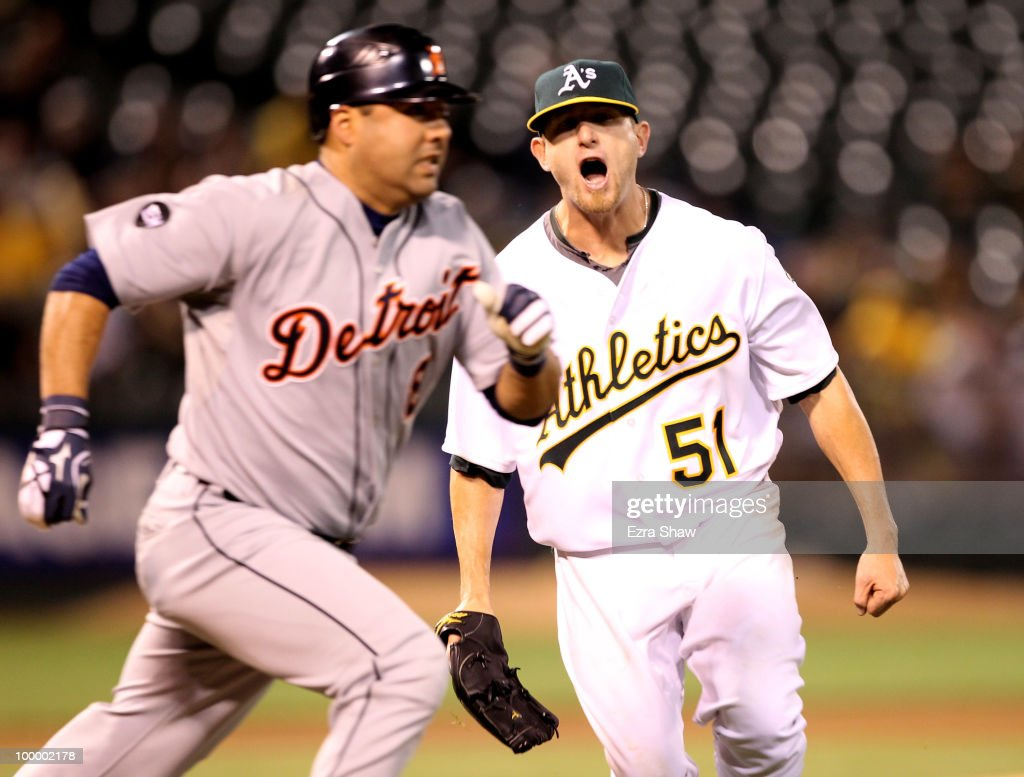 Dallas Braden #51 of the Oakland Athletics reacts after he misplayed a bunt by Gerald Laird #8 of the Detroit Tigers in the seventh inning at the Oakland-Alameda County Coliseum on May 19, 2010 in Oakland, California. Braden injured himself on the play and was taken out of the game.