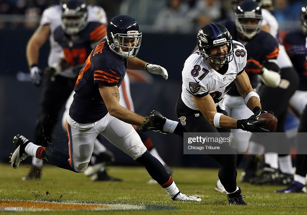 Dallas Clark of the Baltimore Ravens catches a pass in front of Chris Conte of the Chicago Bears during the 1st quarter at Soldier Field in Chicago on Sunday, Nov. 17, 2013.