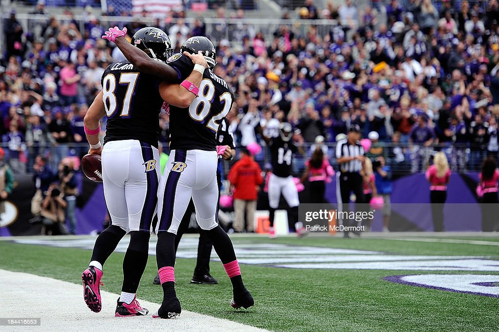 <a gi-track='captionPersonalityLinkClicked' href=/galleries/search?phrase=Dallas+Clark&family=editorial&specificpeople=184501 ng-click='$event.stopPropagation()'>Dallas Clark</a> #87 of the Baltimore Ravens celebrates with <a gi-track='captionPersonalityLinkClicked' href=/galleries/search?phrase=Torrey+Smith&family=editorial&specificpeople=5527843 ng-click='$event.stopPropagation()'>Torrey Smith</a> #82 after scoring a touchdown in the fourth quarter during a game against the Green Bay Packers at M&T Bank Stadium on October 13, 2013 in Baltimore, Maryland.