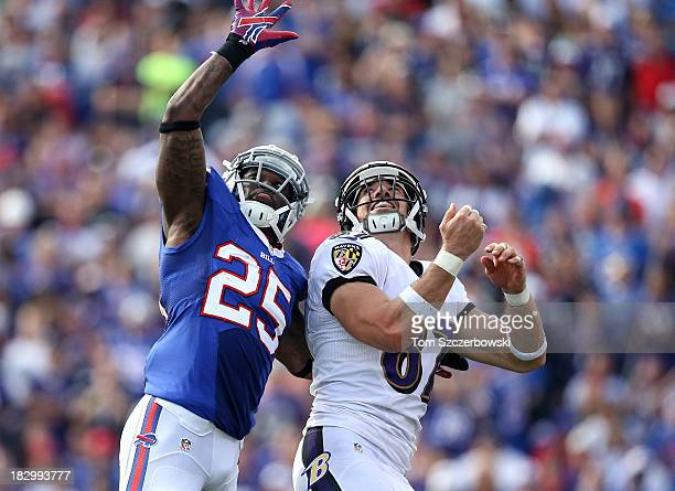 Dallas Clark of the Baltimore Ravens goes after a pass during NFL game action as he is covered by Da'Norris Searcy of the Buffalo Bills at Ralph...