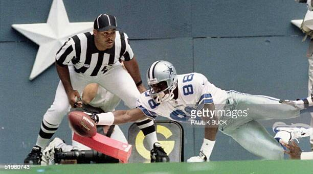 Dallas Cowboy wide receiver Michael Irvin stretches for the goal line during third quarter action against the Atlanta Falcons at Texas Stadium in...