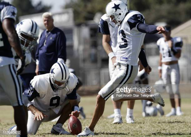 Dallas Cowboys backup quarterback Tony Romo holds for placekicker Mike Vanderjagt as he kicks a field goal during practice The Cowboys held two...
