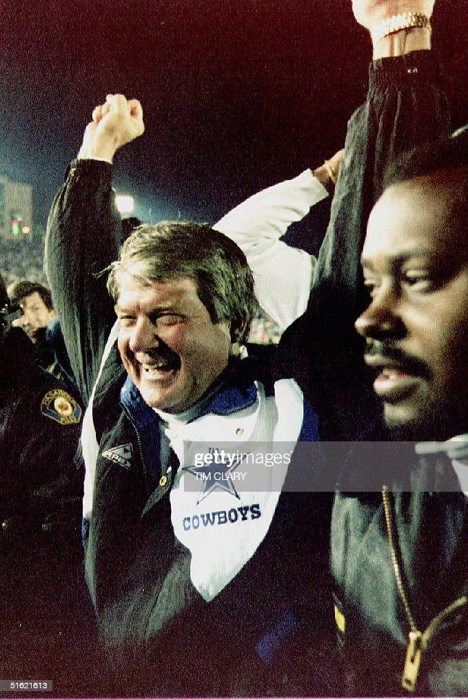 Dallas Cowboys coach Jimmy Johnson raises his hands in the air as he leaves the field after his team defeated the Buffalo Bills 5217 to win Super...