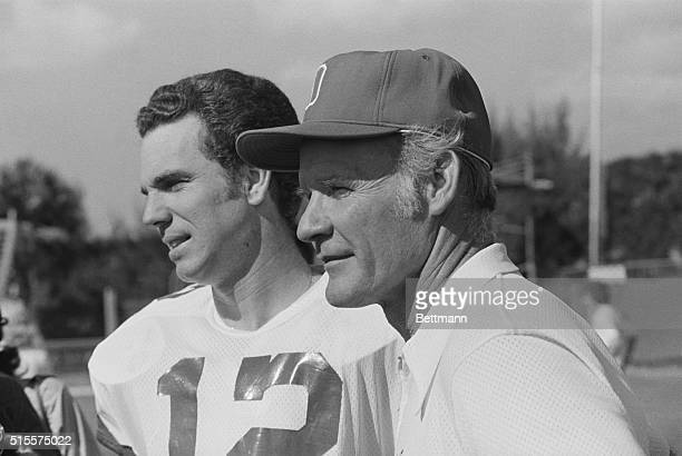 Dallas Cowboys' coach Tom Landry and quarterback Roger Staubach speak with reporters at the Cowboys' Fort Lauderdale training camp