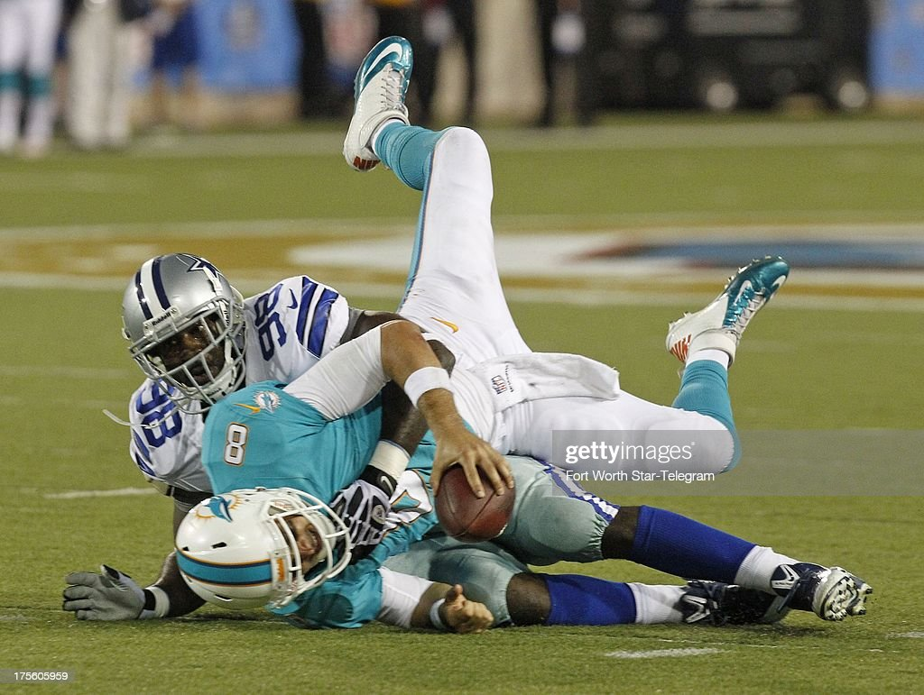 Dallas Cowboys defensive end George Selvie sacks Miami Dolphins quarterback Matt Moore for a nine yard loss in the second quarter of the Hall of Fame Game at Fawcett Stadium in Canton, Ohio, Sunday, August 4, 2013.